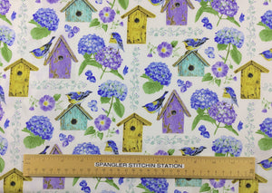 Ruler on fabric to show sizing of flowers and bird houses.