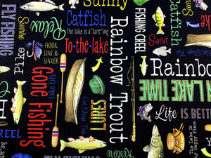 Close up of black cotton fabric covered with fish, row boats, oars, fish and sayings such as hook, line & sinker and more