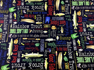 Black cotton fabric covered with fish and fish sayings such as catfish, to the lake, on lake time and more.