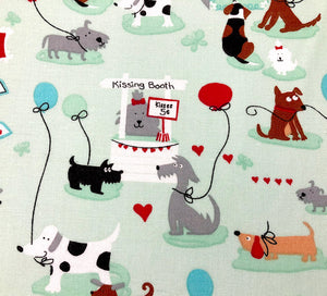 Light green fabric with dogs, balloons, kissing booth and more.