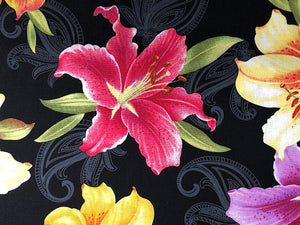 Close up of red lily on black fabric.