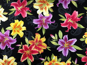 Black fabric covered with yellow, red and purple lilies.