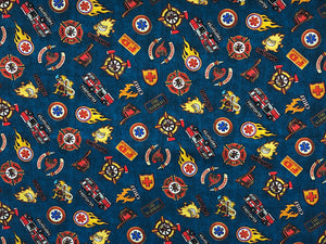 Navy Fabric covered with firetrucks and shields.