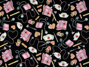 Black cotton fabric covered with medical bags, bandaids, stethoscopes, tongue depressors and more.