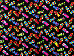 Black cotton fabric covered with colorful flip flops.