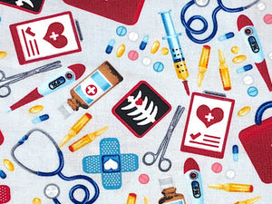 Close up of items that are in a first aid kit such as scissors, bandaids, thermometers and more.