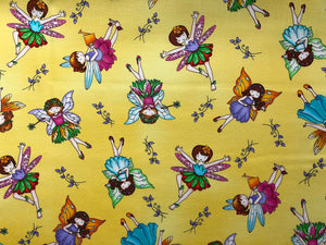 Yellow Cotton Fabric covered with fairies.