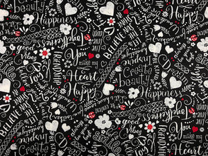 Black cotton fabric covered with happy words.
