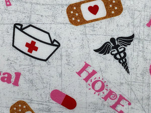 Close up of hometown hero fabric that is covered with nurse hats, band-aids and nurse sayings