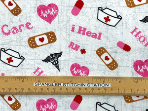 Ruler on Cotton Fabric covered with nurse hats, band-aids and nurse sayings