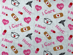 Cotton Fabric covered with nurse hats, Band-Aids and nurse sayings