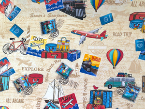 Cream colored fabric covered with luggage, airplanes, hot air balloons, bicycles, stamps and more.