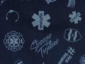Close up of blue cotton fabric covered with first responder emblems