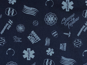 Close up of blue cotton fabric covered with first responder emblems.