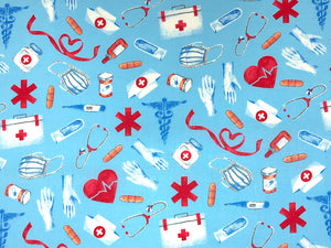 Cotton fabric covered with stethoscope's,  masks, medical symbols and more.