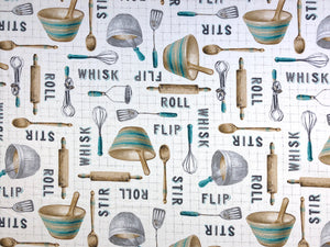 Cream colored cotton fabric covered with bowls, spoons, whisks, rolling pins and more.