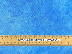 Ruler on blue cotton shadow play fabric