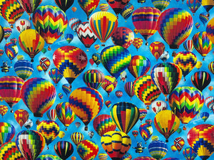 Blue cotton fabric covered with hot air balloons.