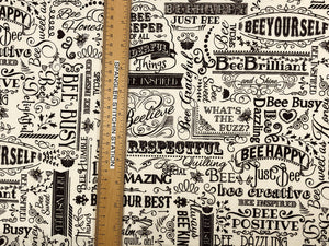 Ruler on fabric showing sizing of words.