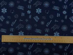 Ruler on blue cotton fabric showing sizing.