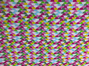 Fabric covered with half circles in various colors