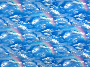 Blue fabric covered with clouds and rainbows.
