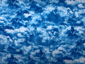 Cotton fabric covered with clouds.