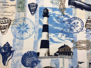 Close up of Light house on blue and white cotton fabric.