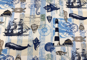 Cotton fabric covered with ships, sea shells, light houses, whales, sea horses and more.