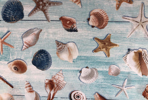 Cotton Fabric covered with sea shells.