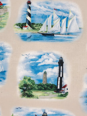 Close up of lighthouses and boats on cotton fabric.