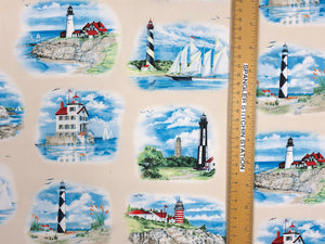 Ruler on cream colored cotton fabric that is covered with lighthouses and boats.