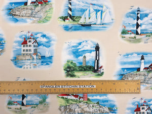 Ruler on cream colored fabric that is covered with lighthouses and boats.