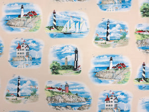 Cream cotton fabric covered with lighthouses and boats.