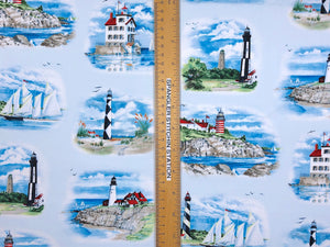 Ruler on fabric horizontally to show sizing of lighthouses.