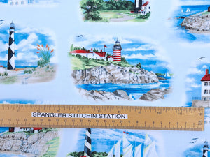 Ruler on fabric horizontally to show size of lighthouses.