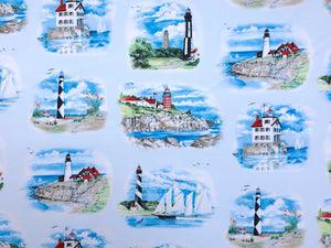 Light blue cotton fabric covered with different lighthouses.