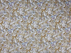Sand colored fabric covered with sand dollars.