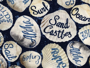 Close up of seashells with words such as sand castles, aloha and more.