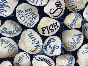 Close up of seashells covered with words such as fish, beach, swim and more.