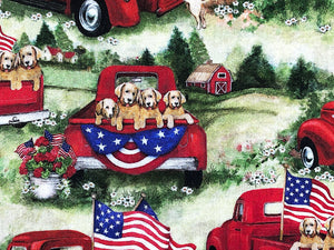 Close up of patriotic pups in  a red truck