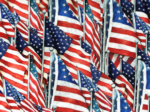 Close up of cotton fabric which is covered with USA flags.