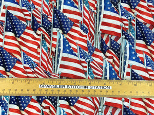 Ruler on cotton fabric which is covered with USA flags.