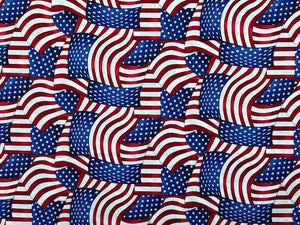 Cotton fabric covered with red, white and blue USA Flags.