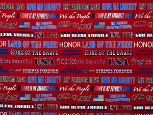 Red fabric covered with patriotic sayings such as home of the brave, give me liberty and we the people.