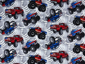 Tossed Trucks cover a grey and white flag background.