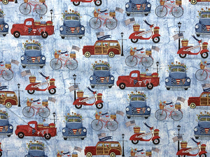 Patriotic fabric covered with red and blue trucks,  cars and bicycles.