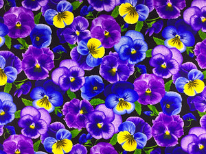 Black fabric covered with purple, blue and yellow pansies with green leaves.