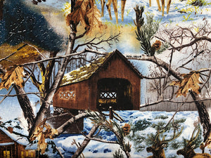 Close up of covered bridge, snow and trees in the winter.