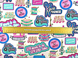 Pink sewing themed fabric with a ruler on it to show sizing